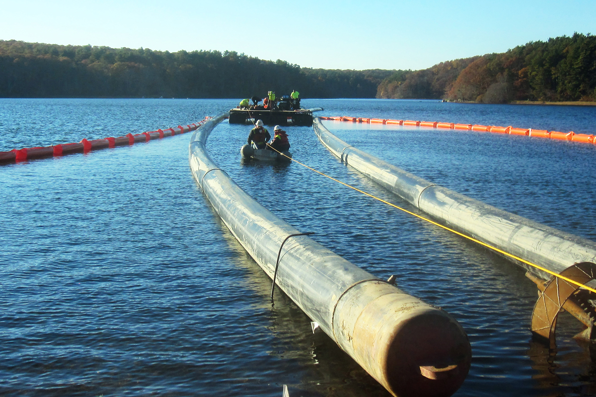 Floating 24 inch piping into Long Pond in preparation to accept directional drilling head