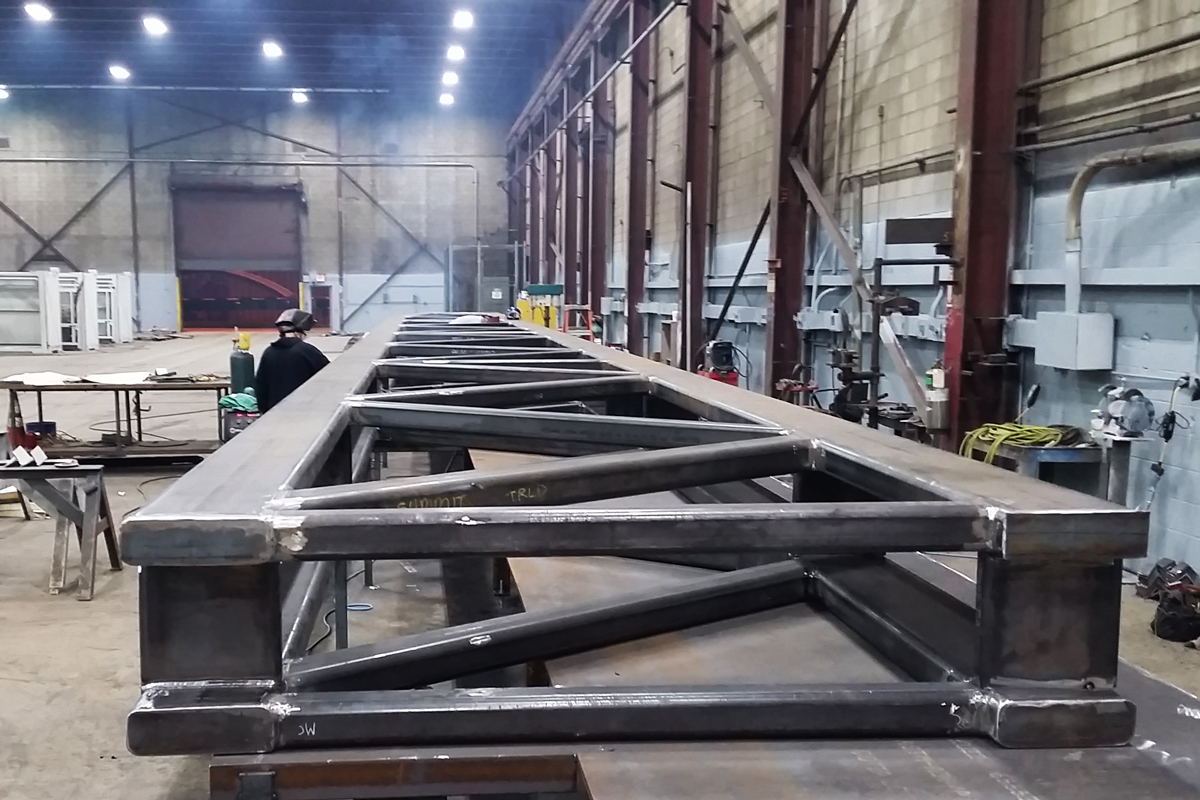 Fabricating the 80' long truss in our fabrication shop