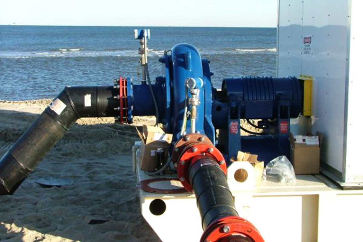 A pump connected and ready to operate on the beach