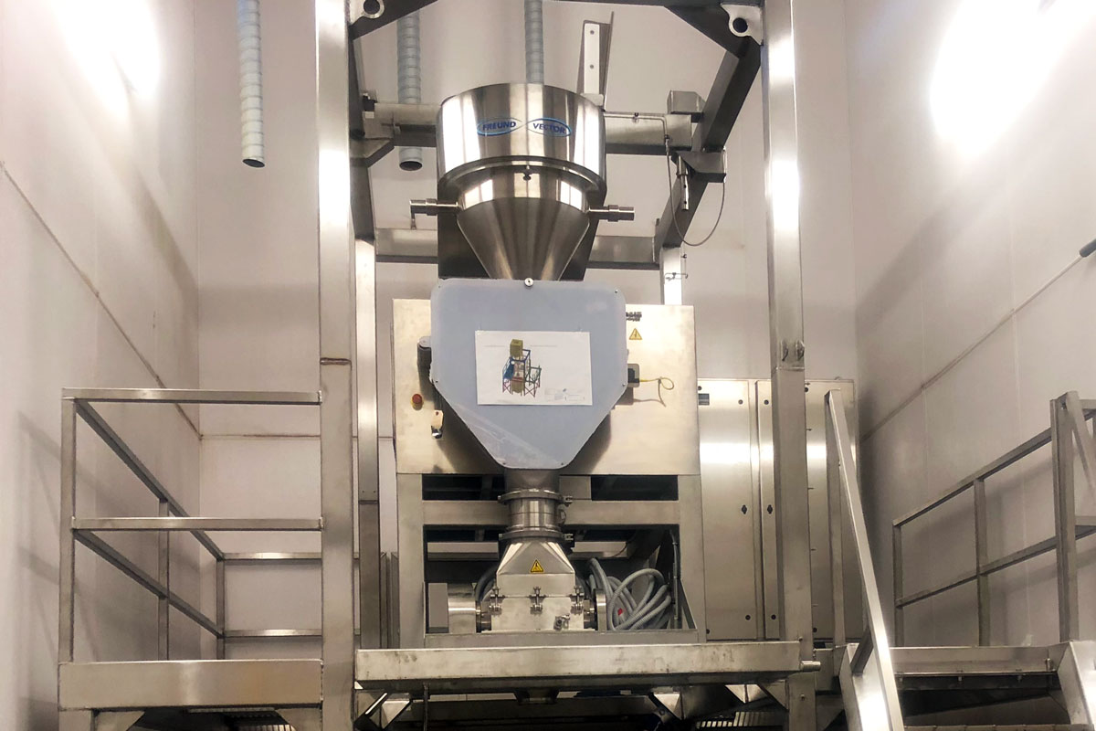 The new food roller press compactor installed in the new stainless steel frame