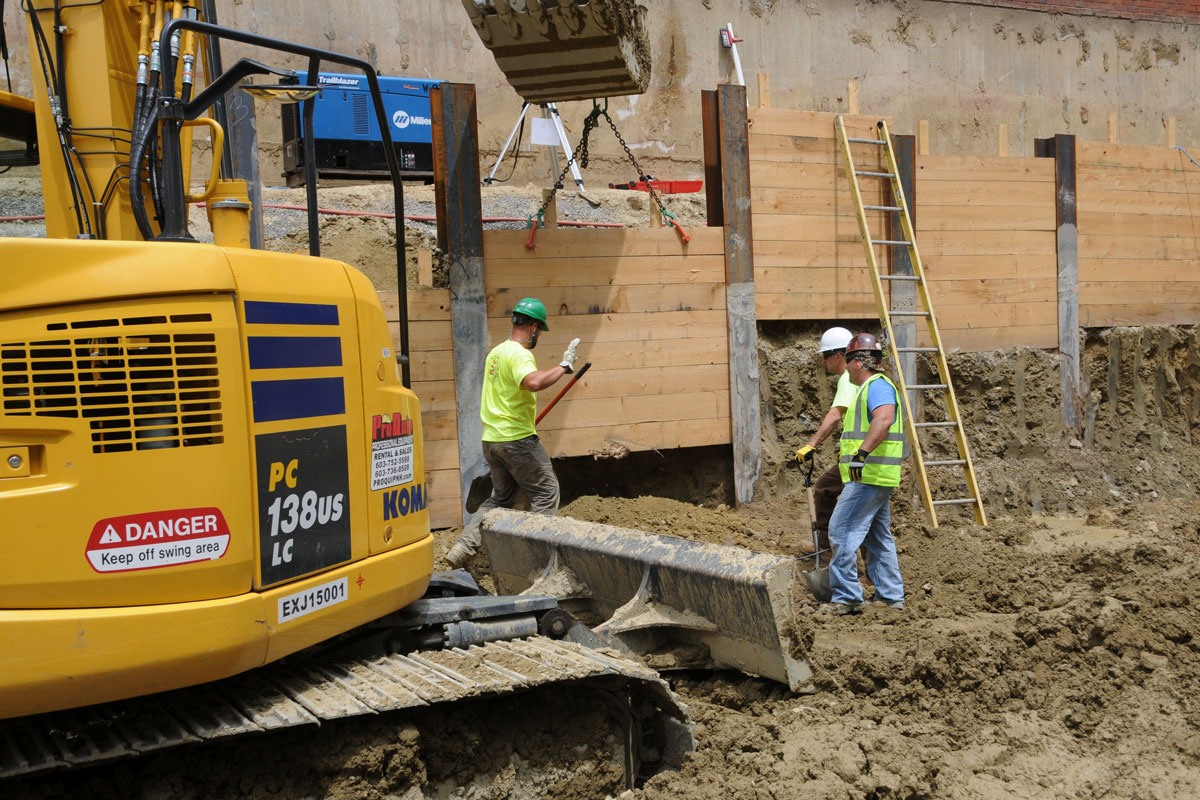 Securing the new construction site with a retaining wall