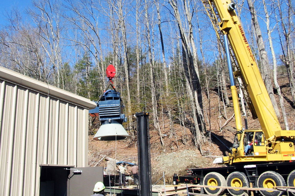 Hoisting the turbine into position at the Glendale Dam