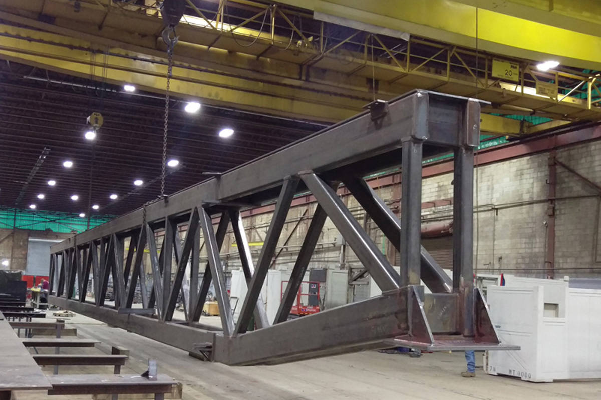 85 foot long 25,000 pound steel truss that supports 50,000 pound modular roof section