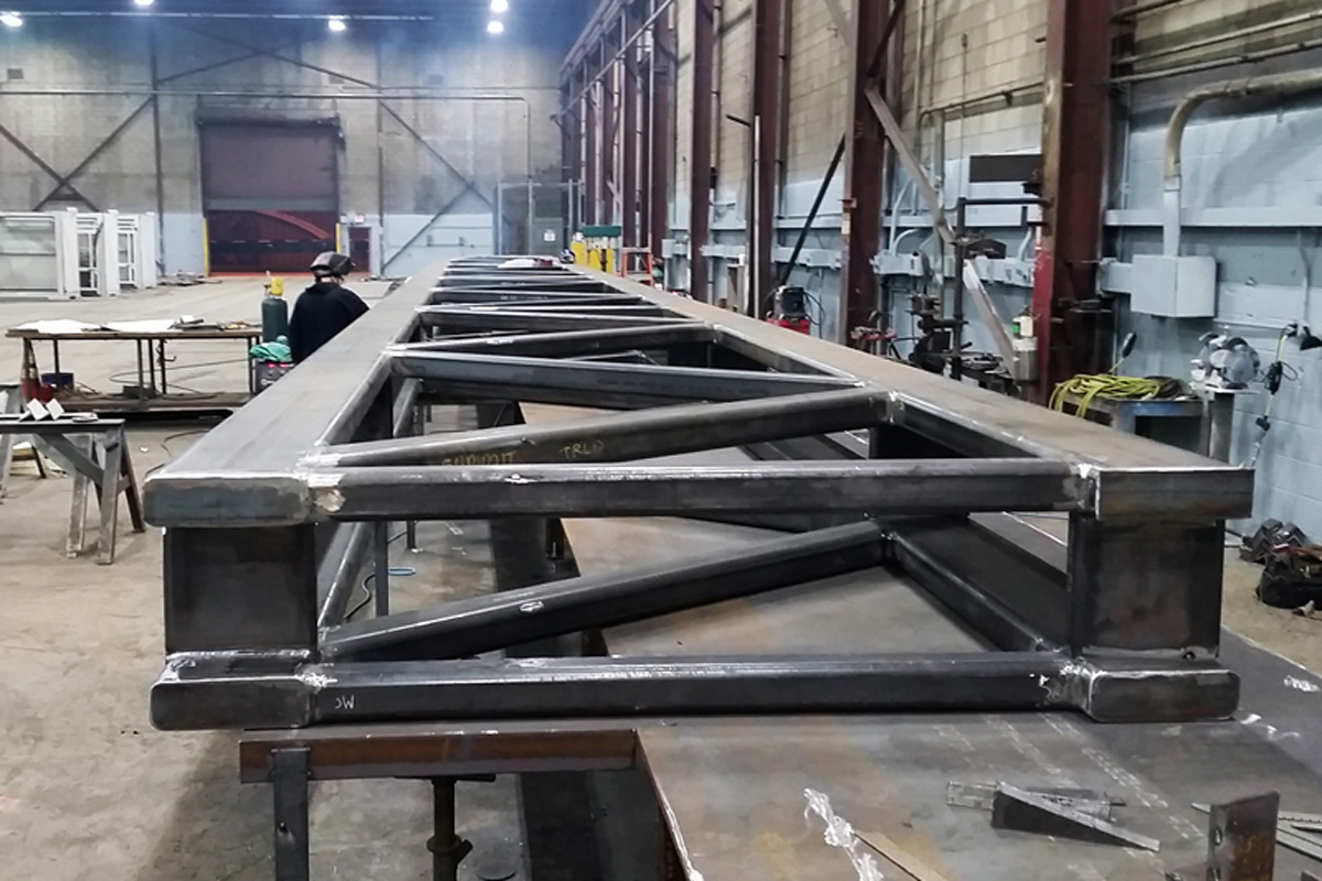85 foot long steel truss being fabricated