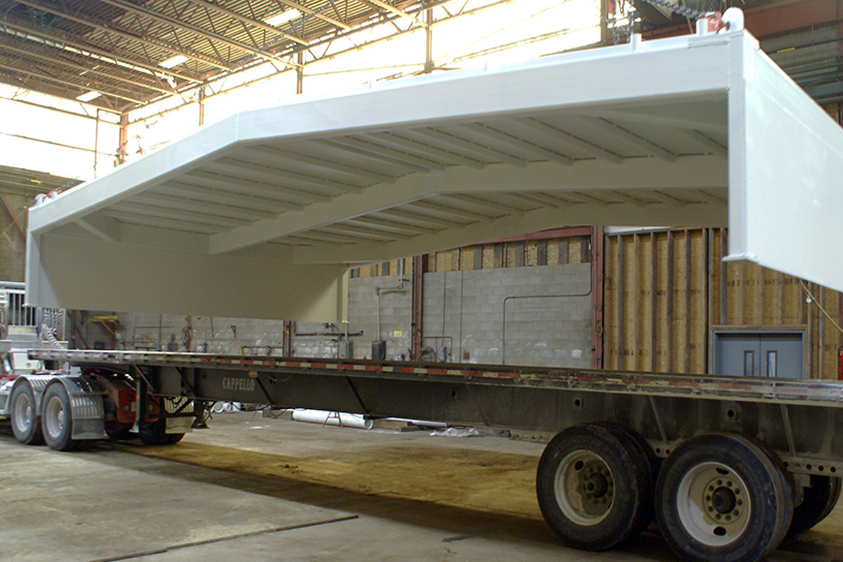Loading a completed roof for trucking to the Naval Shipyard