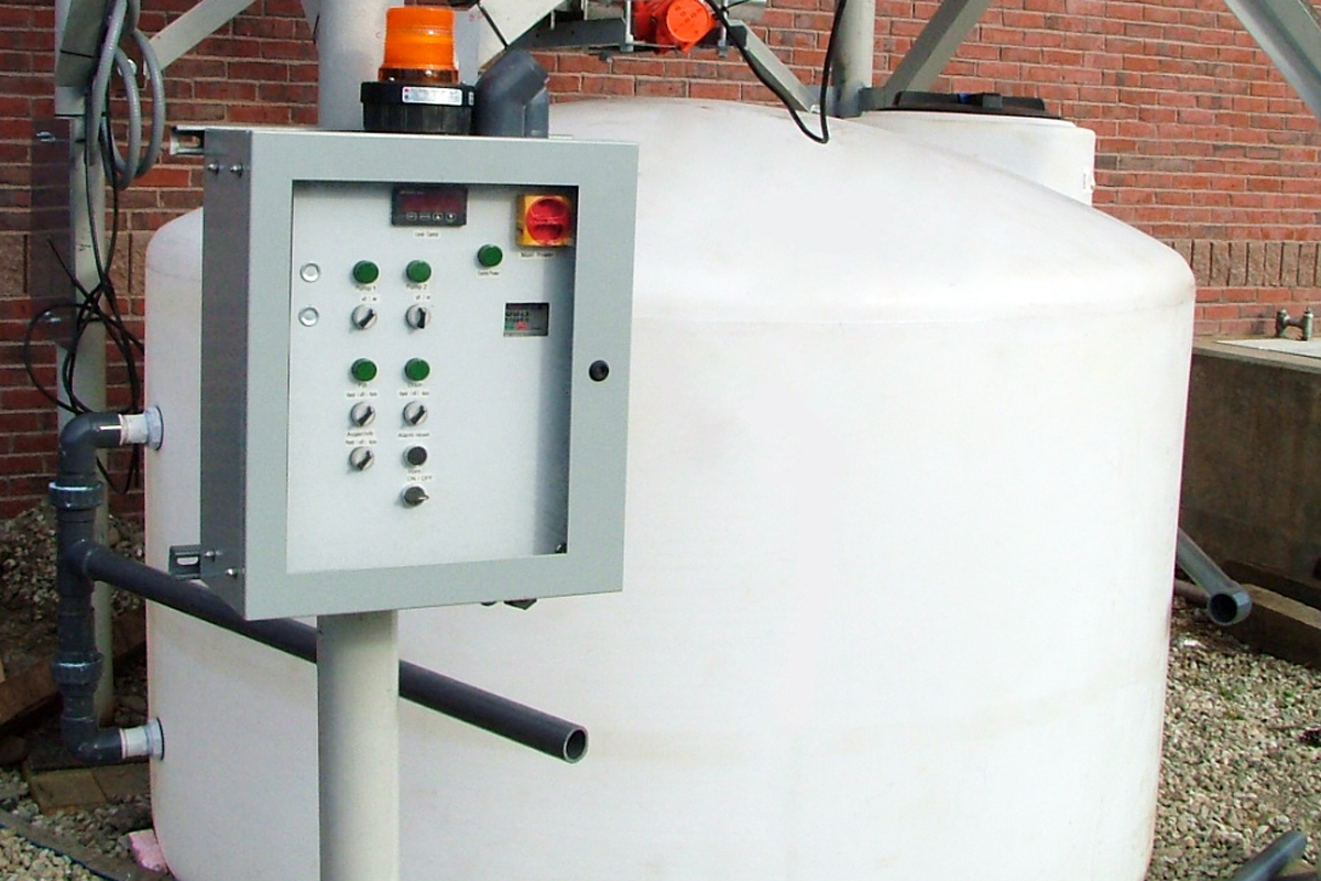 Lower tank of ash silo with control panel
