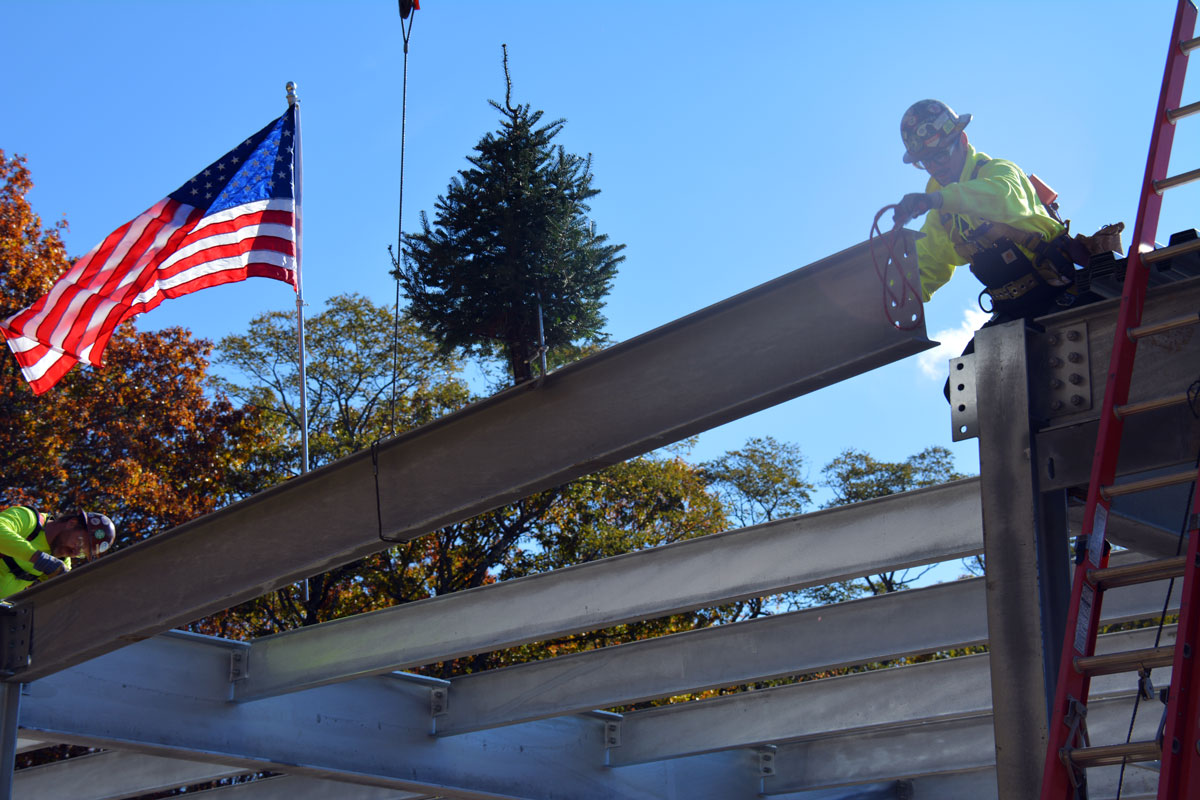 Placing the last structural steel member at the topping off ceremony