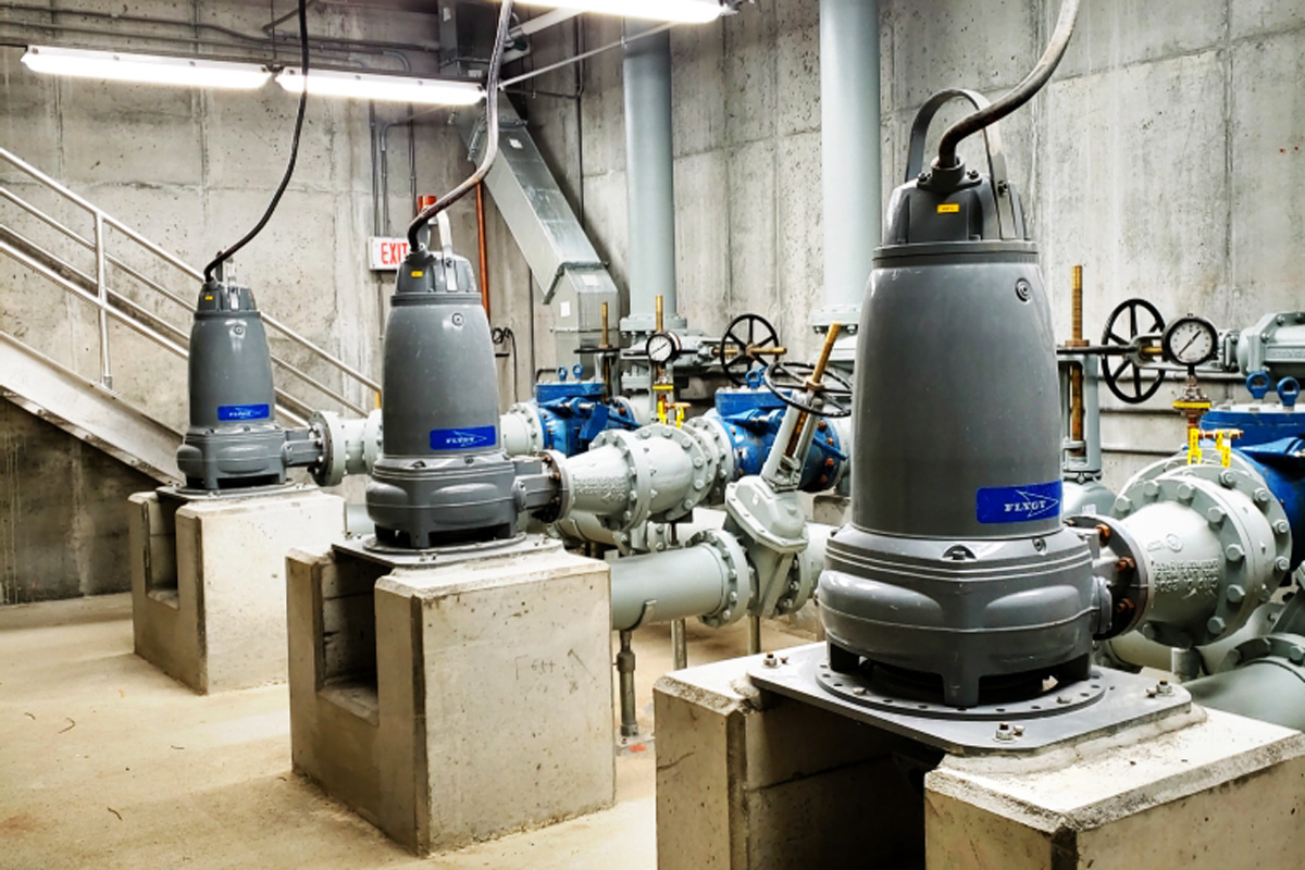 Three dry-pit submersible pumps with suction and discharge piping