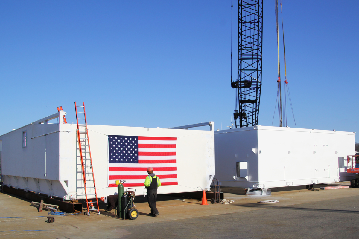 Finalizing the modular unit on the Portsmouth, NH city dock before transport to the shipyard