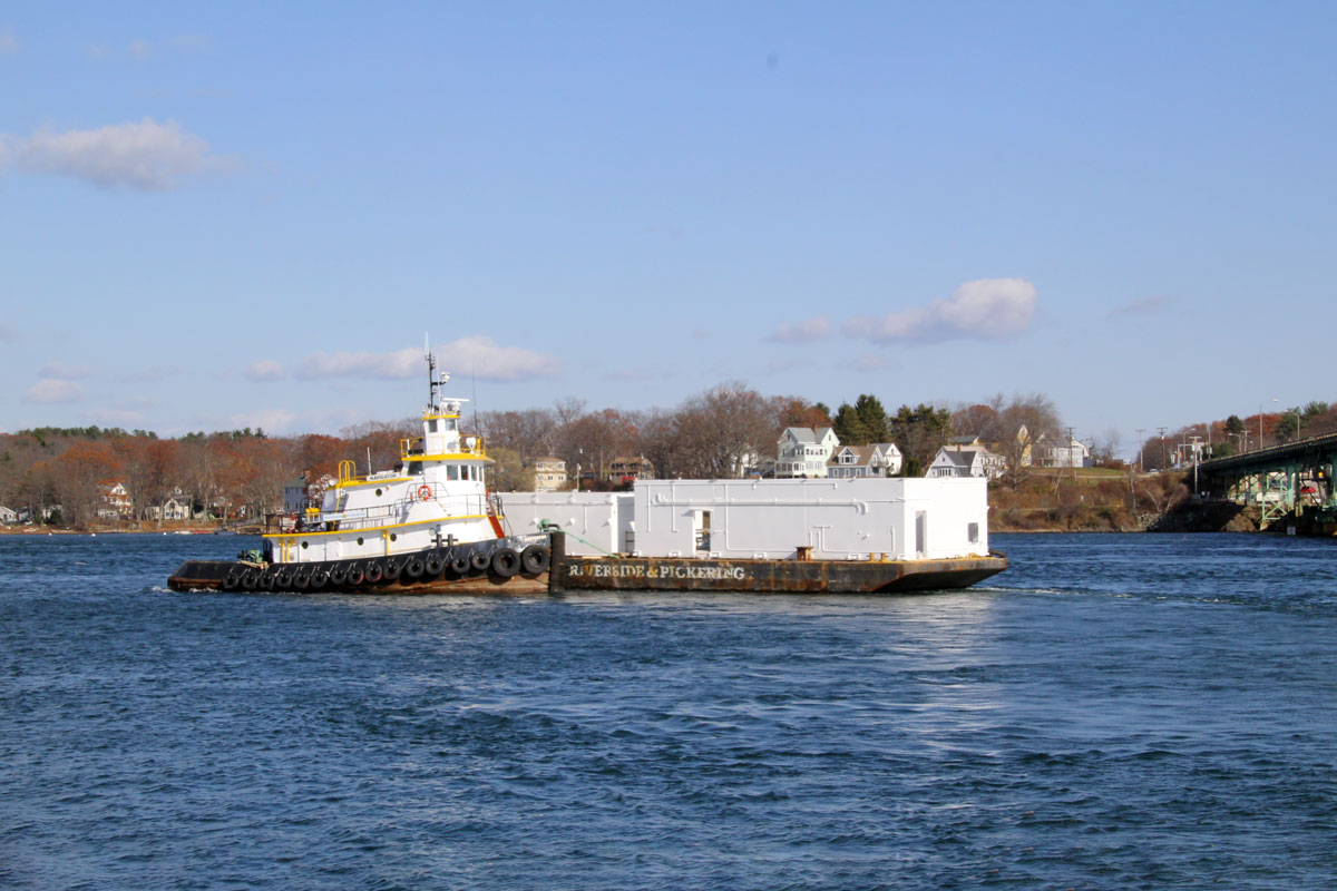 Transporting the modular unit via tugboat and barge to the Portsmouth Naval Shipyard