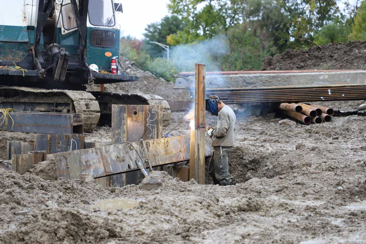Welding pilings that will stabilize the ground for the foundation of the new headworks building