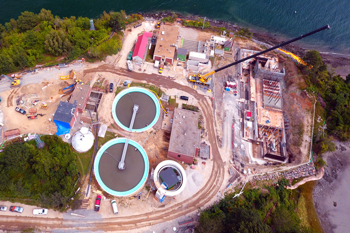 Looking down at the primary clarifiers and current solids processing building to right