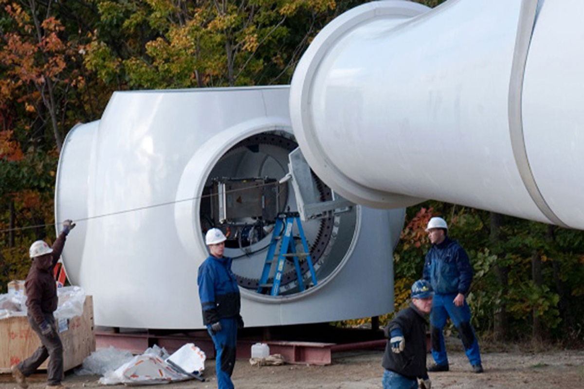 Attaching the wind turbine blades.
