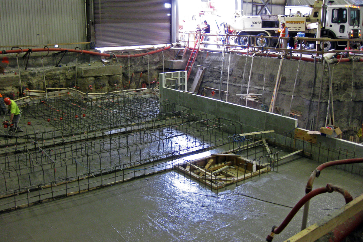 The 4 foot thick slab required a unique foundation system to support the extreme weight of the slab
