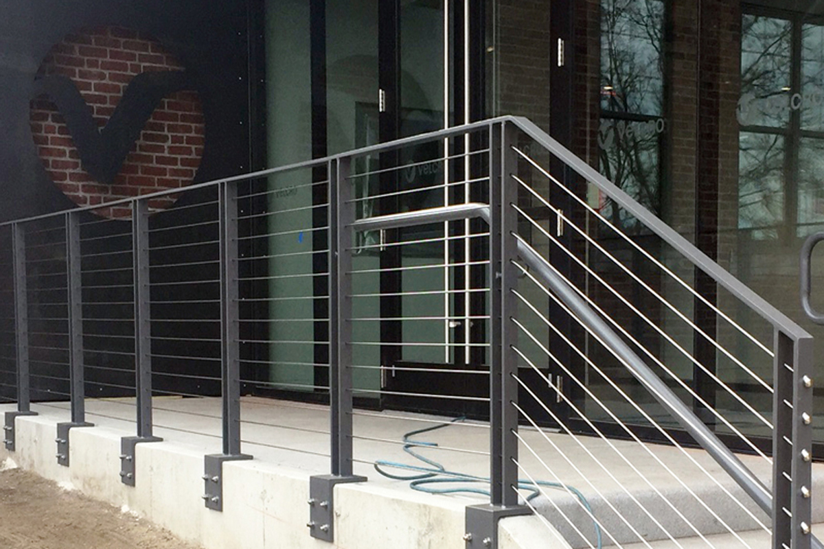 Cable steel railings and Velcro logo for the new side entrance